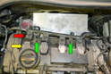 Begin by separating the four wiring harness connections (red arrow) from the coils (yellow arrows).