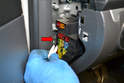Use the fuse removal tool on the back of the panel and remove the fuse for the fuel pump (red arrow).