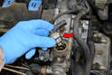 Use a large adjustable wrench and remove the sensor from the pump.