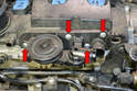 Next, remove the four T25 Torx screws holding the valve assembly to the valve cover (red arrows).