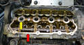Make sure to clean the surface of the head (red arrow) well including around the spark plug openings (yellow arrow).