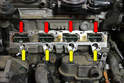 With manifold and injectors off you can see the intake ports (red arrows) and the injector ports (yellow arrows).