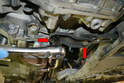Use a 16mm socket and remove the two bolts (red arrows) holding the mount to the transmission.