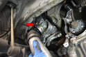 Wiggle and pull the down pipe until it separates from the turbo (red arrow).