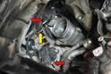 Disconnect the wiring harness from the cut off valve and bypass regulator (red arrows) and disconnect the plastic tab holding the harness to the turbo (yellow arrow).