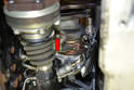 Remove the 13mm bolt holding the turbo to the mounting bracket (red arrow).