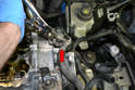 Label and separate the coolant hose from the end of the metal line (red arrow).