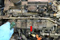 You will need to remove the intake manifold (red arrow).