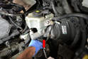 Use a T30 Torx and remove the single bolt holding the switch to the master cylinder (red arrow).