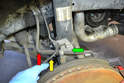 The ABS sensor (yellow arrow) and brake line (red arrow) are attached to the steering knuckle (green arrow) and do not need to be removed.