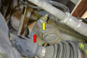 There is an 18mm nut (yellow arrow) and a 16mm triple square bolt (red arrow) that