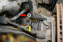 With the bolt removed (red arrow) spray the area between the strut and housing with some penetrating oil.