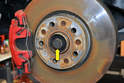 You can also create more room by removing the 27mm nut that holds the axle to the housing (red arrow).