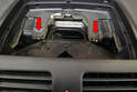 With the panel removed and set aside, remove the two T20 Torx screws holding the vent trim piece to the dash (red arrows).