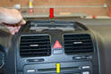 With the clips free lift the rear of the panel up and slightly forward (red arrow).