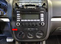 The radio or center trim panel is one piece (red arrow).