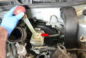 You'll want to try and get as much brake fluid as you can out of the fluid reservoir (red arrow) on top of the master cylinder.