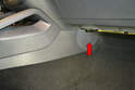 Use a trim removal tool and remove the small protective panel (red arrow) on the forward section of the kick or trim panel.