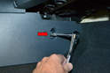 Use a T20 Torx driver and remove the single screw holding the trim panel in place (red arrow).