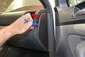Begin by using a trim removal tool and gently prying the dash end cap off (red arrow).