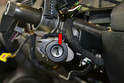 To remove the lock cylinder you will need a firm paper clip or 3/36-inch drill bit to inset into the hole in the ignition cylinder (red arrow).