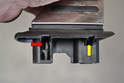 This image shows the clip on the left side (red arrow).