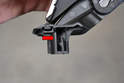 This photo illustrates the right side clip (red arrow).