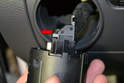 Headlight Switch - Pull the switch far enough from the dash that you can unplug the harness from the back (red arrow).
