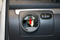 Use a T20 Torx and remove the single T20 Torx screw located behind the headlight switch (red arrow).