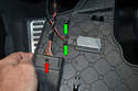 Remove the OBD II port by releasing the retaining clip (red arrow) with a small screwdriver.
