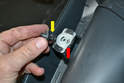 Using the trim removal tool to remove the clip from the door frame will re-expand the clip (yellow arrow).