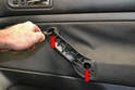 Passenger Door Handle - Use a T30 Torx and remove the two screws (red arrows).