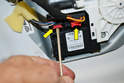 Window Motor: Begin by pulling the two red tabs out on the wiring connection (yellow arrows).