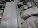 Loosen the two captive Phillips head screws (green arrows) along the rear edge of the air filter housing.