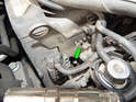 Shown here is one of the spark plugs with the wire/insulator removed (green arrow).