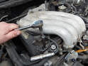 For all four cylinders - Use a 5/8 spark plug socket to remove the spark plug down below.