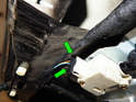 Squeeze the two fingers (green arrows) on the electrical connection going to the actuator and pull it out.
