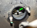 When fitting the new master cylinder, take care that the end of the mounting bore fits correctly over the drive piston (green arrow) in the brake booster.