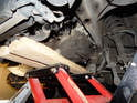 Before beginning the job, it is crucial that you support the underside of the transmission with either a floor jack or an ATV as shown here.