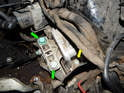 Now loosen the front 13mm bolt (yellow arrow) holding the front of the transmission mount to the chassis.