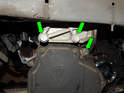 Loosen and remove the three 16mm bolts (green arrows) holding the mounting plate to the transmission and pull it off.