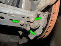 Left and Right Sides - Loosen and remove the three 13mm bolts (green arrows) holding the control arm to the wheel hub.