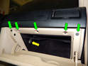 Loosen and remove the five T20 Torx screws (green arrows) along the top edge of the glove box.