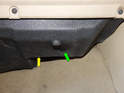 From underneath the glove box, loosen and remove the plastic tab (green arrow) using a flathead screwdriver.