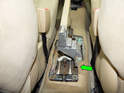 Shown here is the location of the parking brake adjustment nut at the rear of the parking brake (green arrow).