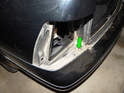 Left and Right Sides of car: Loosen and remove the T30 Torx screw (green arrow) holding the bumper cover to the chassis.