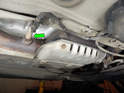 Loosen and remove the rear oxygen sensor (green arrow) from the catalytic converter.