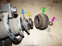 Shown here are the components that retain the coil spring in the proper positions.