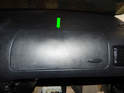 Pull the airbag cover up from the front edge (green arrow) and fold it back and up over the dashboard.