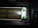 Loosen and remove the two T27 Torx screws (green arrows) from the right side of the airbag.